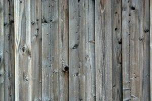 Verweerd houten schutting